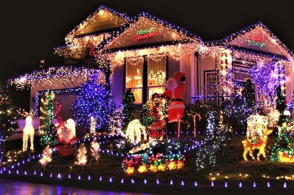 House decorated with many lights and figurines for Christmas