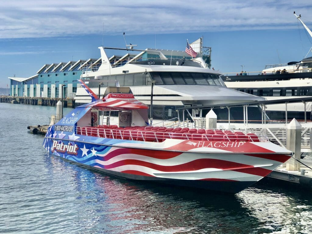 Patriot Jet Boat Thrill Ride Speed boat with red white and blue flag colors docked at the San Diego Broadway pier