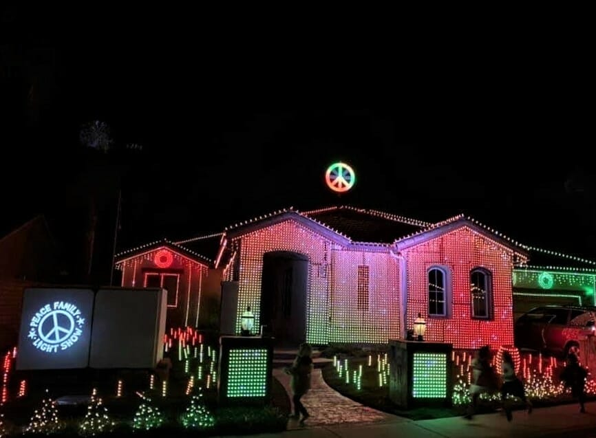 Peace Family House Escondido decorated for Christmas with Peace sign over house