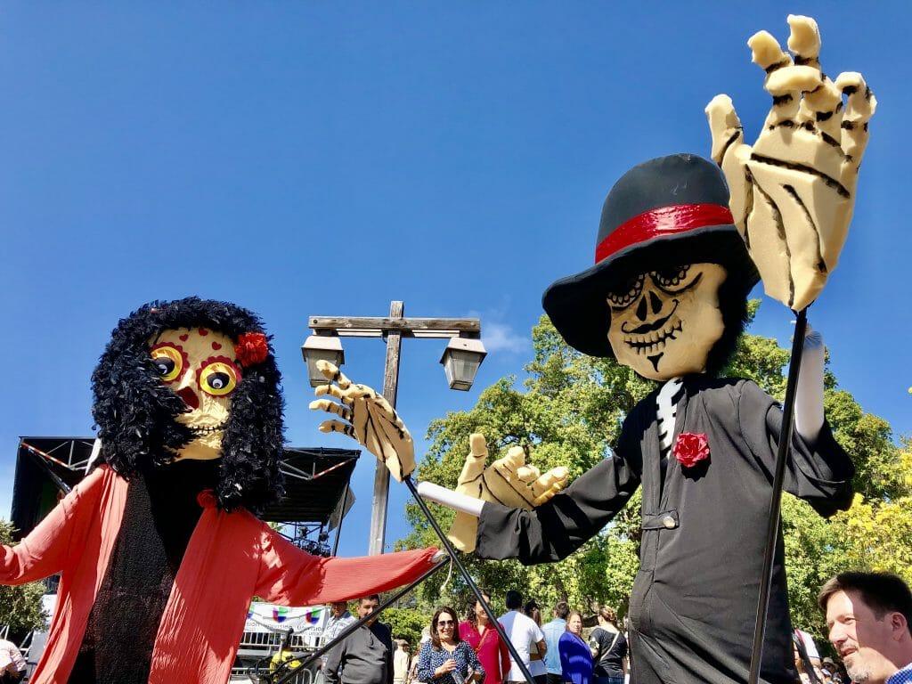 two wood figurines on Cinco de Mayo Old Town San Diego