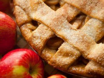 Lattice crust apple pie with whole apples in the bottom corner - Best Apple Pie Bakeries Julian