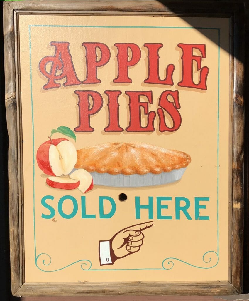 Historic sign in orange and red reading: Apple Pies sold here