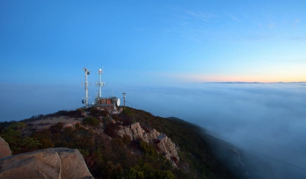 Marine layer almost reaching the top of Cowles Mountain with radio antennas on the peak