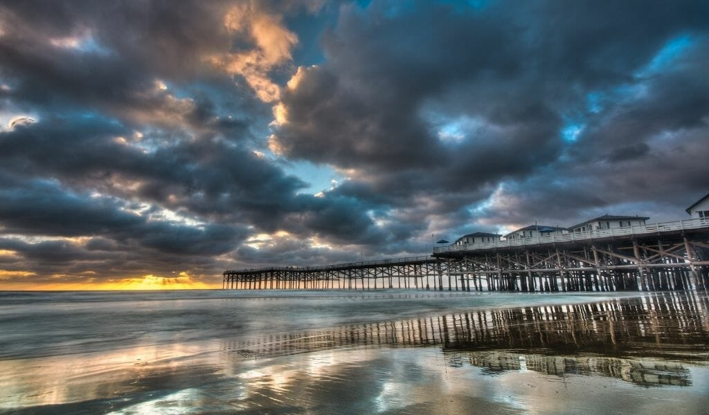 Dramatic cloudy sky during sunset over Crystal Pier Pacific Beach - San Diego Sunsets