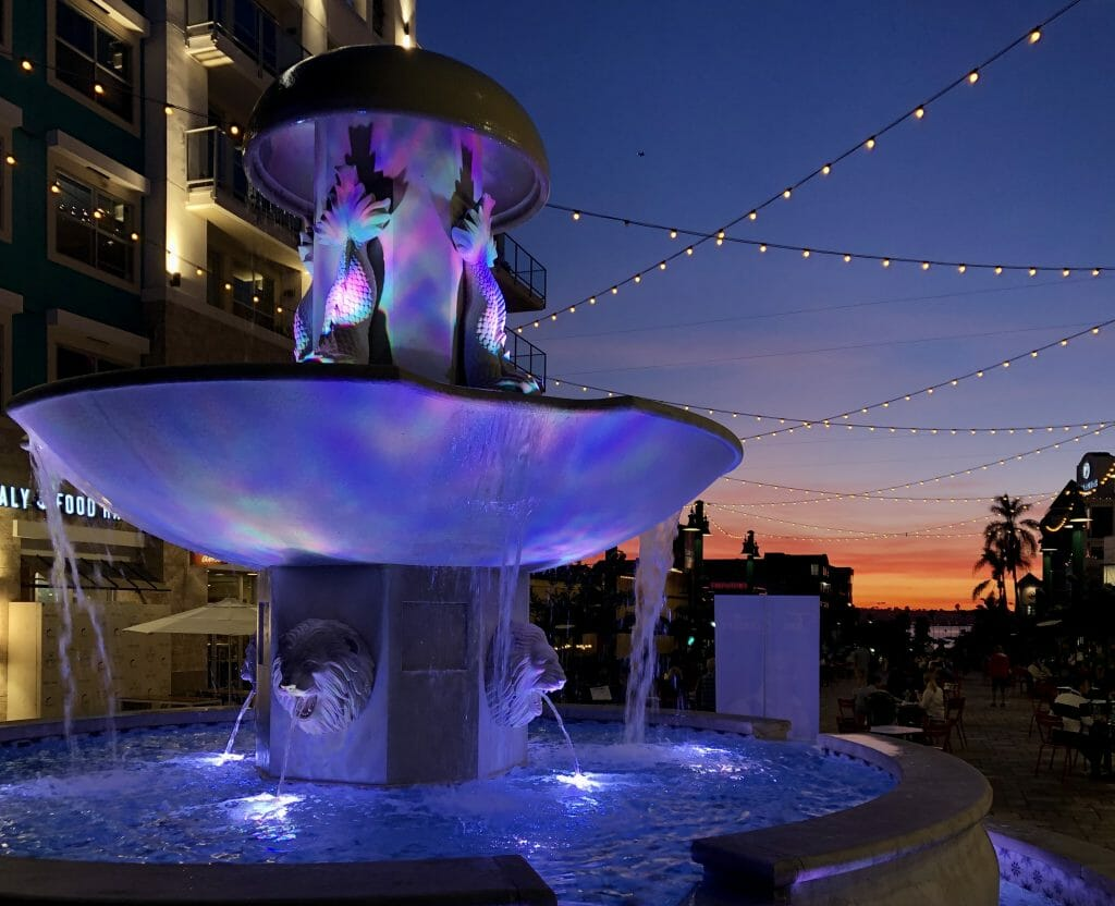 Purple lit up fountain at Piazza della Familia Little Italy San Diego
