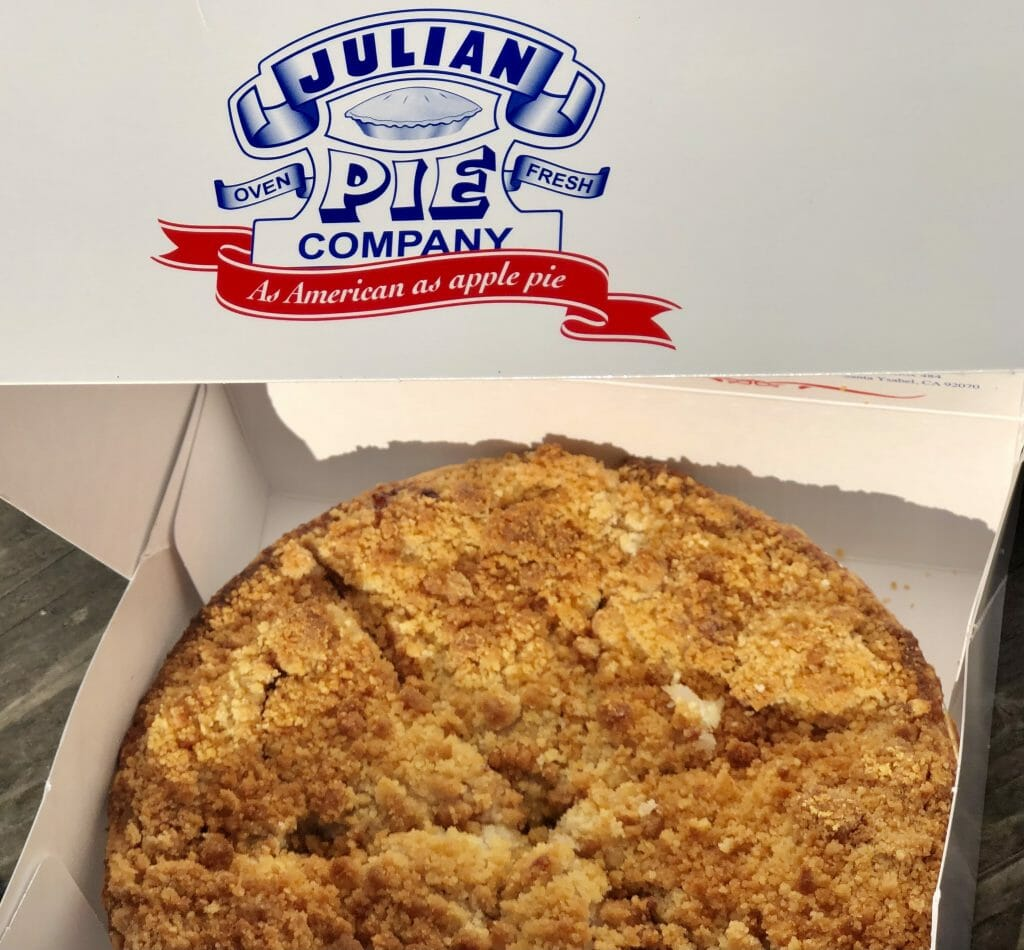 Whole Apple Crumble pie in a white box with writing: Julian Pie Company