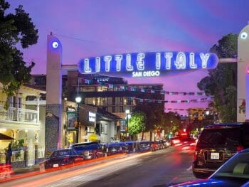 """Neon sign """"Little Italy"""" over street in Little Italy San Diego during sunset"""