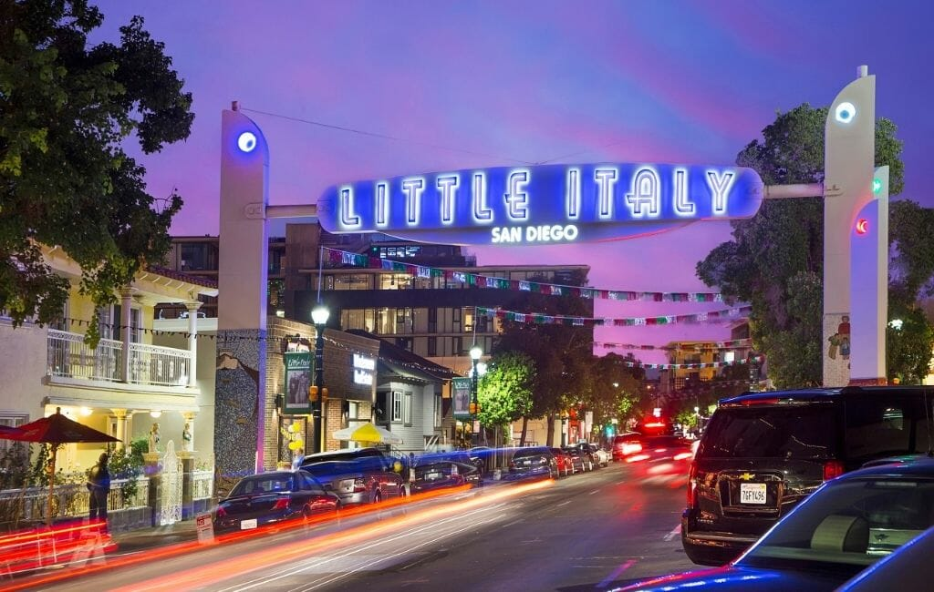 "Neon sign ""Little Italy"" over street in Little Italy San Diego during sunset"
