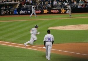 baseball player running to next base at Padres vs Rockies game at Petco Park