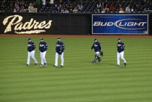 5 padres players walking over the field at Petco Park