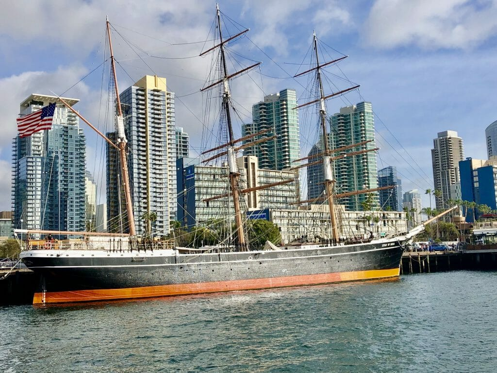 Historic Sailboat Star of India with highrises of San Diego Downtown in the Background
