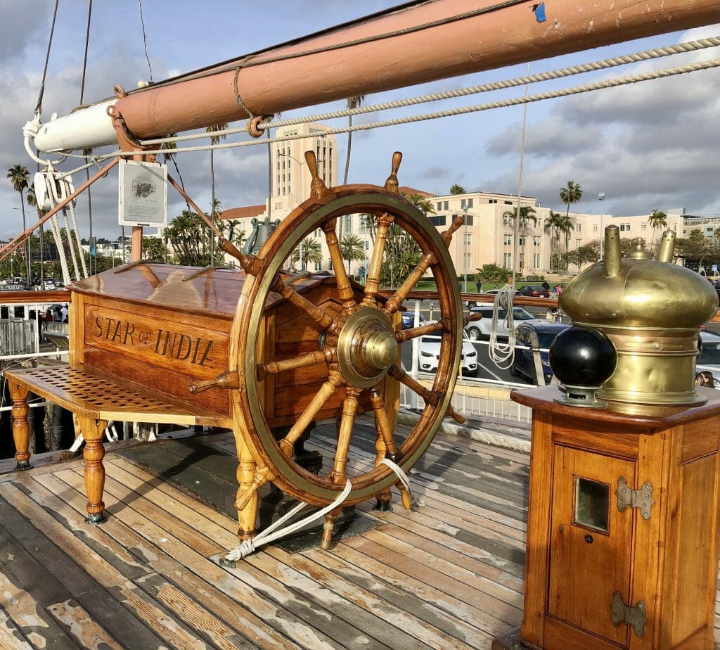 wood helm on board of historic sail boat Star of India San Diego