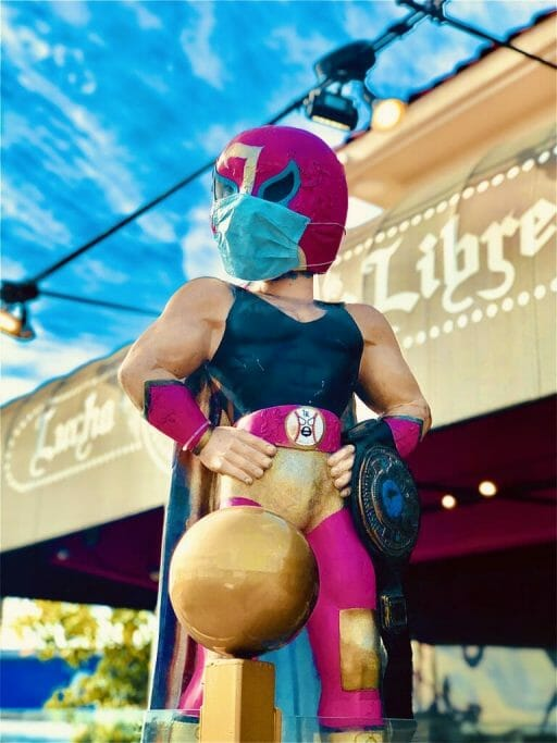 Mexican wrestler figurine with pink mask - icon of Lucha Libre Taco shop San Diego