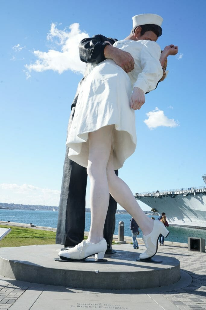 Famous statue of soldier kissing nurse in white nurse uniform based on famous photo of a real life scene on Times Square after the surrender of Japan and the end of World War II