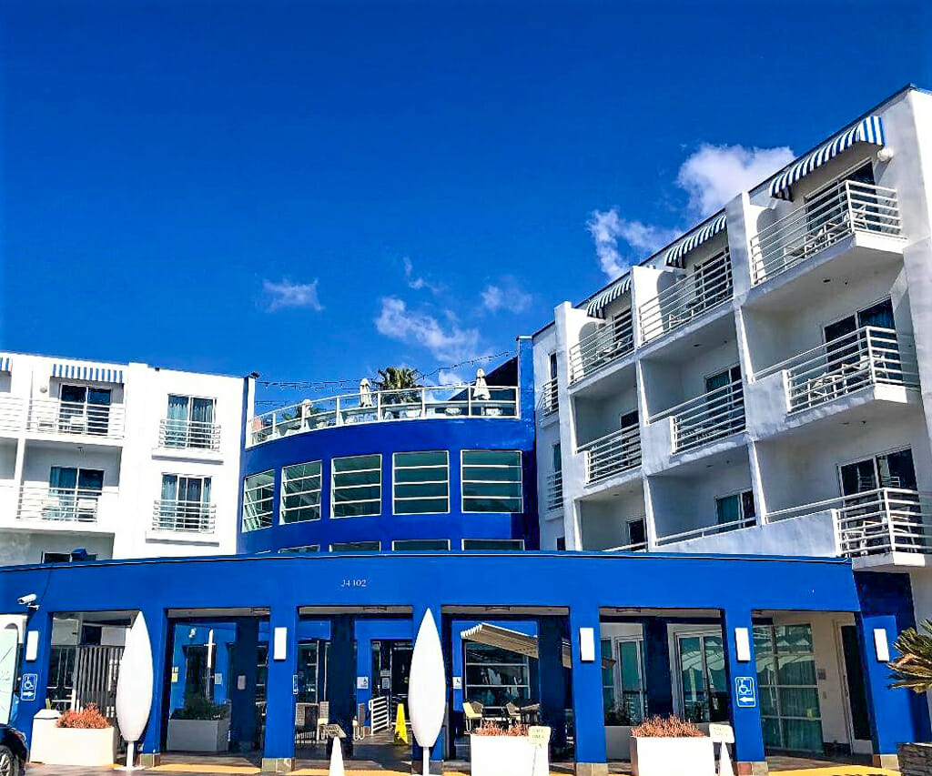 Blue and white building - DoubleTree Suites by Hilton Doheny Beach