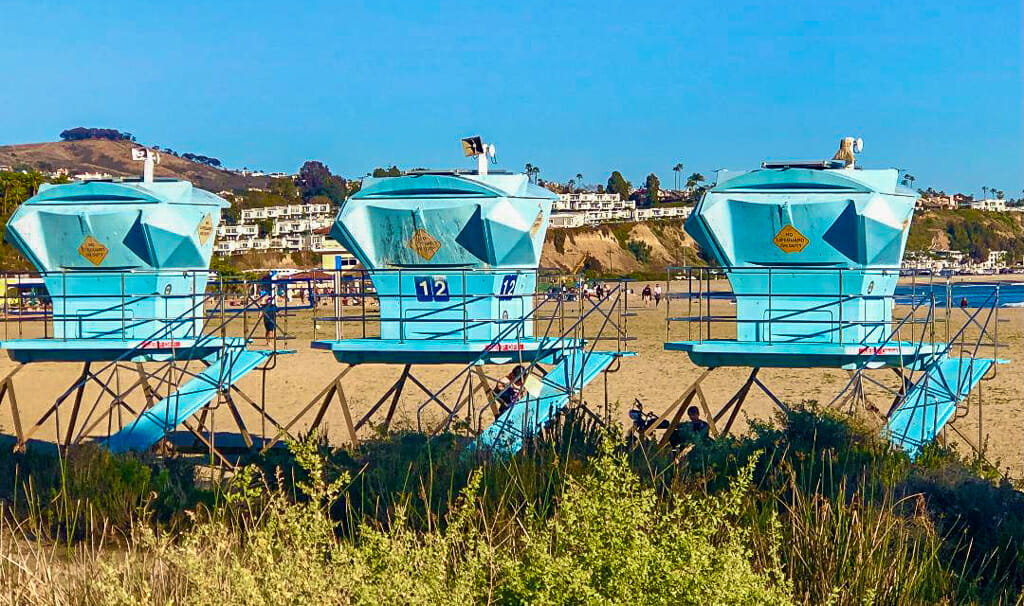 3 turquoise lifeguard towers at Doheny Beach Dana Poing
