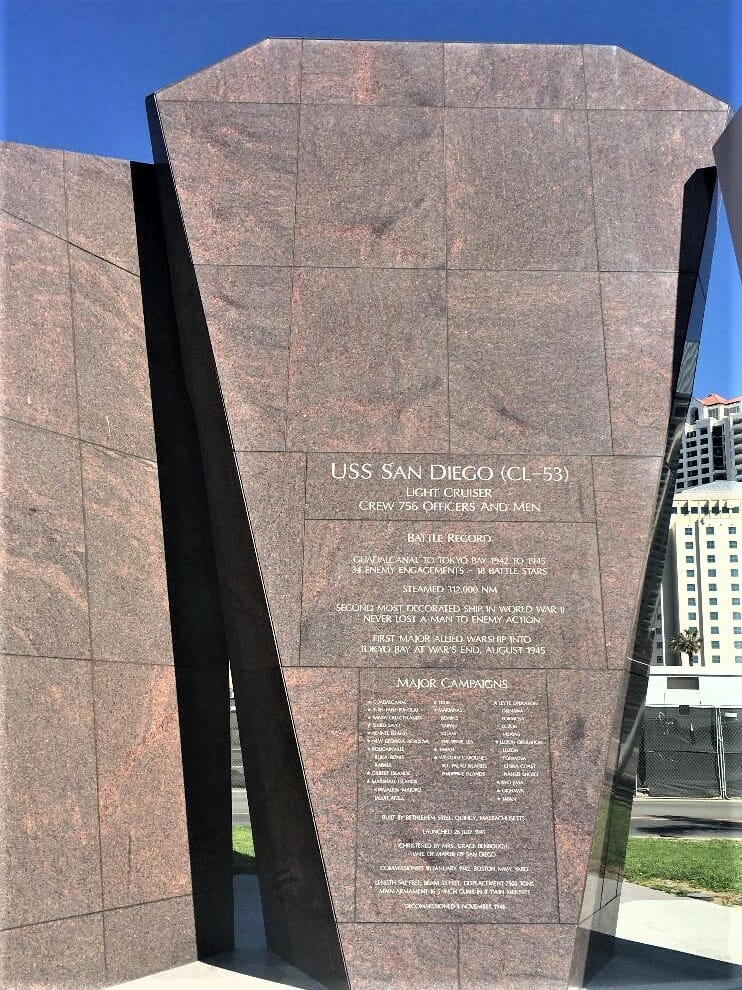 Red granite stone plates with brass writing - USS San Diego Memorial