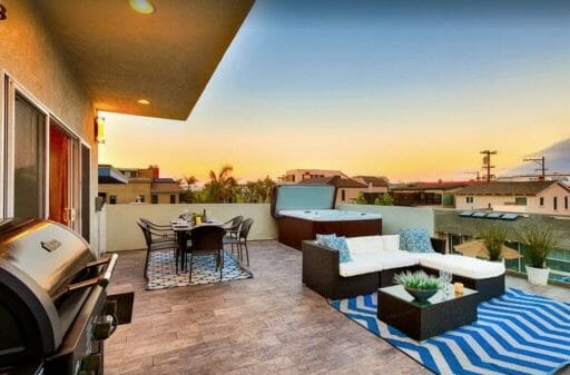rooftop patio with lounge sofa, dinig table, BBQ and hot tub