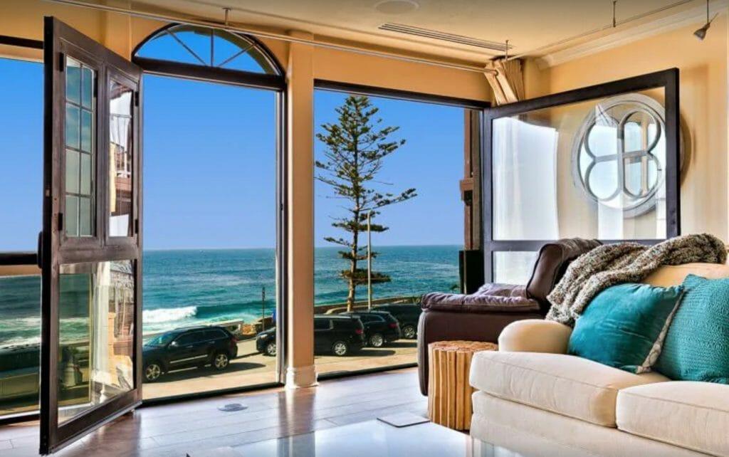 Elegant living room with windows overlooking the ocean - luxury La Jolla vacation rentals