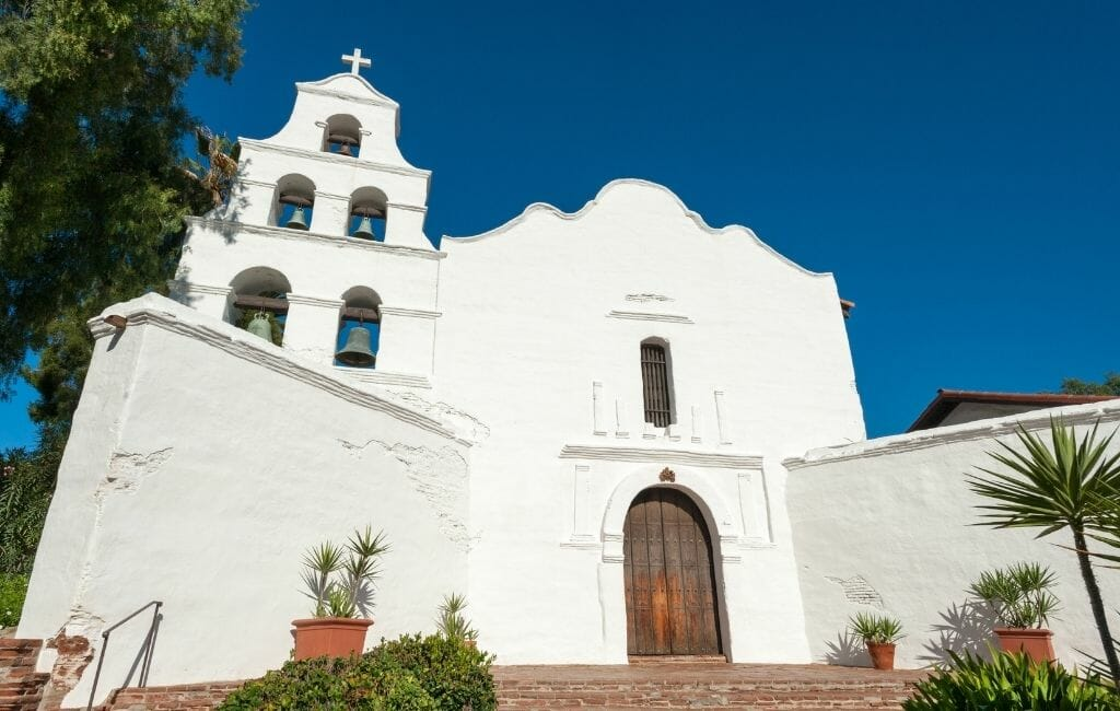 White spanish style church with 5 bell tower - San Diego Mission - San Diego History