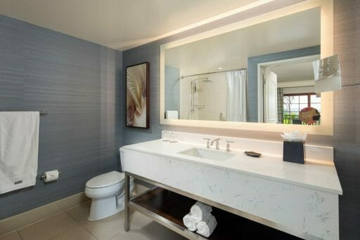 Modern Bathroom at the Westin Carlsbad with large white sink and countertop, a large back-lid mirror