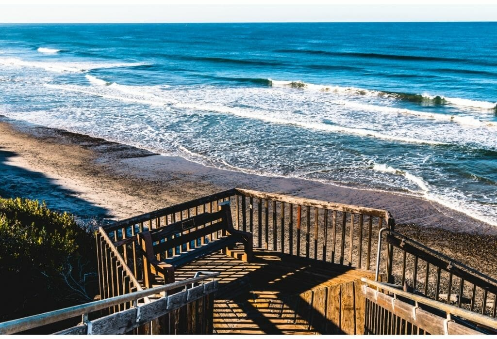 wooden stairs leading from the coastal bluffs down to the beach at Carlsbad State Beach