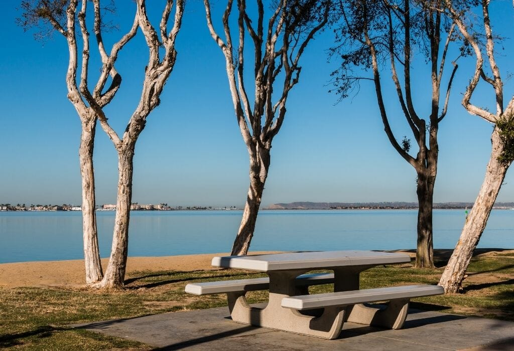 picknick table and bench with trees overlooking the bay in Chula Vista