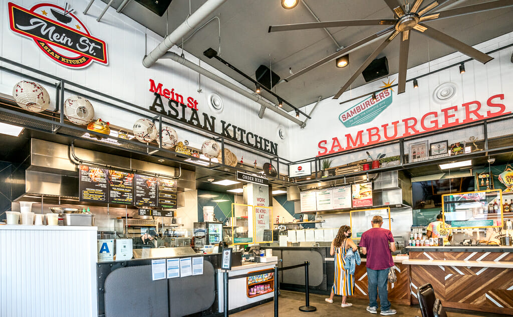 Inside of Little Italy Food Hall - order counters of MeinSt Asian Kitchen & Samburgers food station