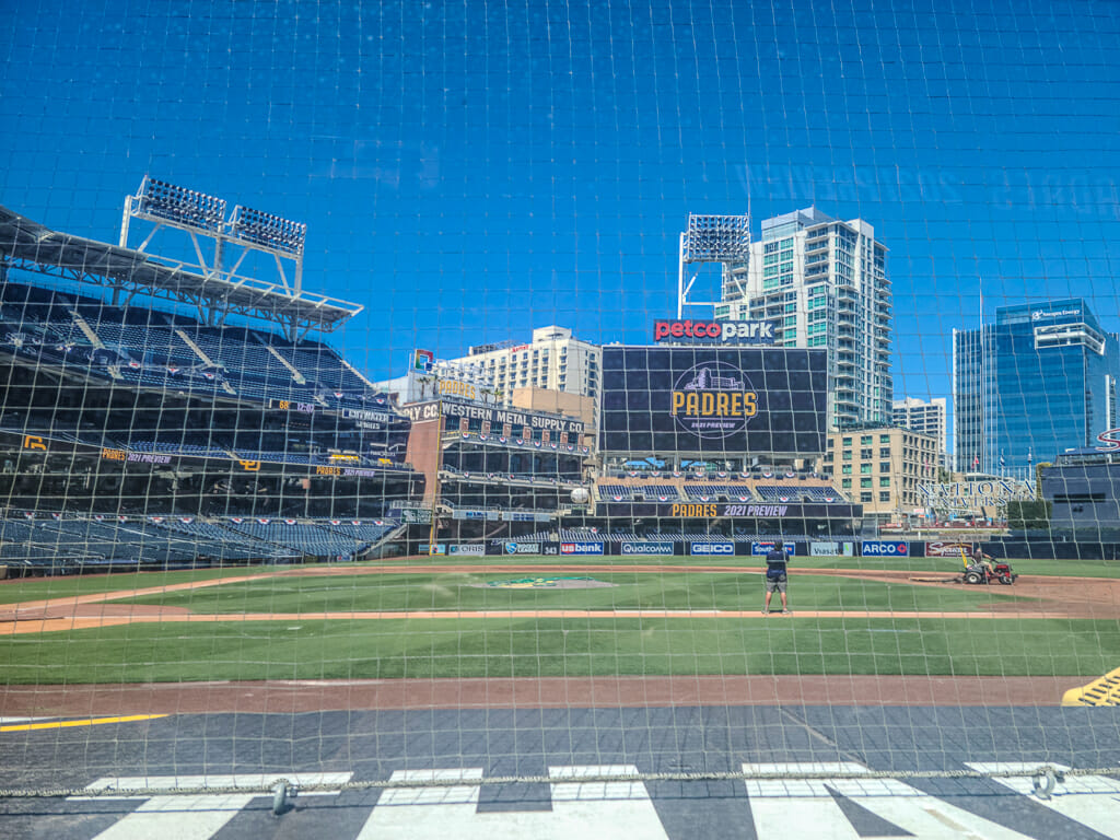 View of Petco Park Baseball Field from the lower ground seats with San Diego Downtown highrises in the background