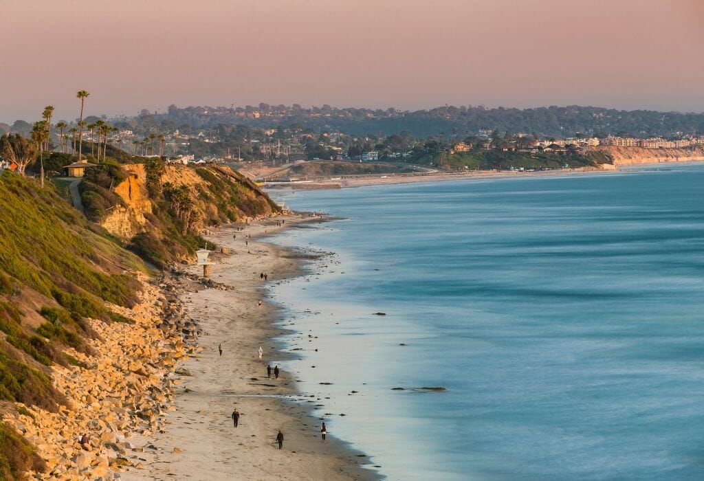 view over the coast line at San elijo state beach with ocean on the right and beach and bluffs on the left