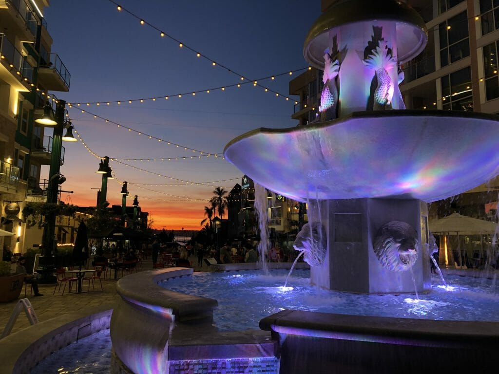 Sunset Piazza Della Famiglia with purple lid up fountain in the foreground