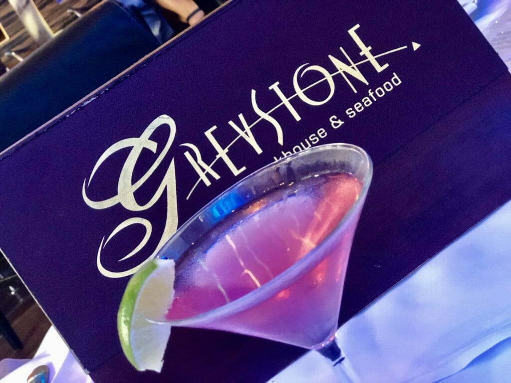 Greystone San Diego menu with pink cocktail in a martini glass in front
