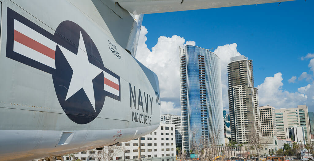 Historic Navy Aircraft on the USS Midway Aircraft carrier with the San Diego skyline in the background - San Diego Military bases