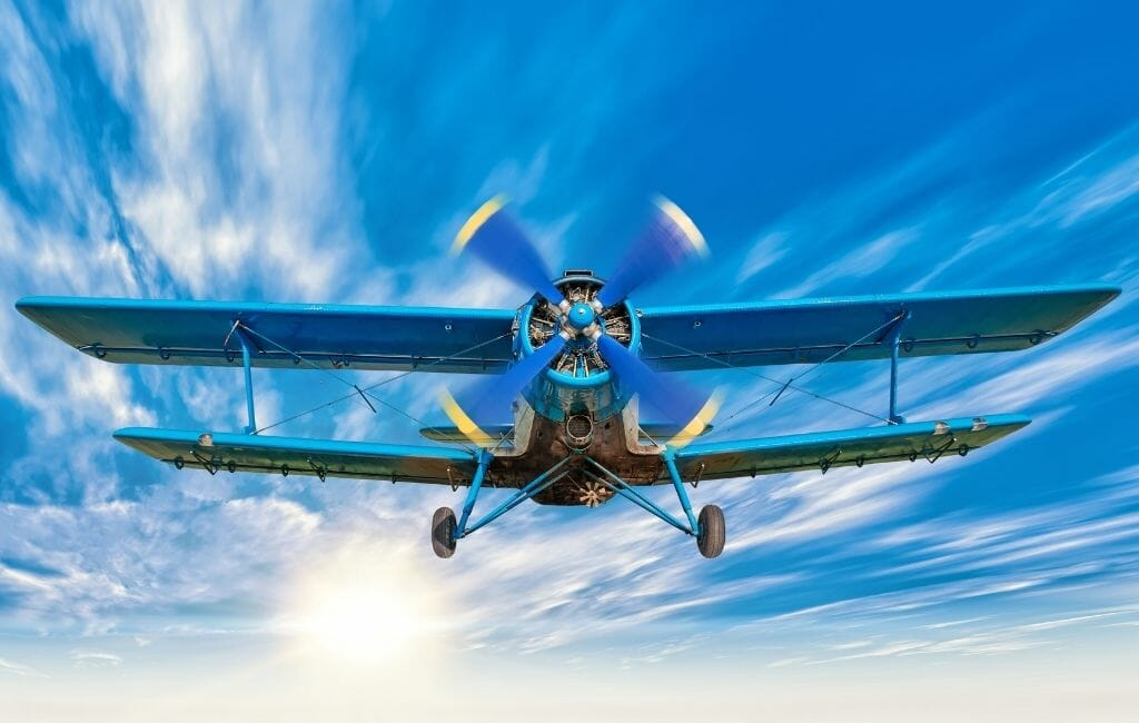 Blue Biplane photographed from the front bottom - Biplane Ride San Diego