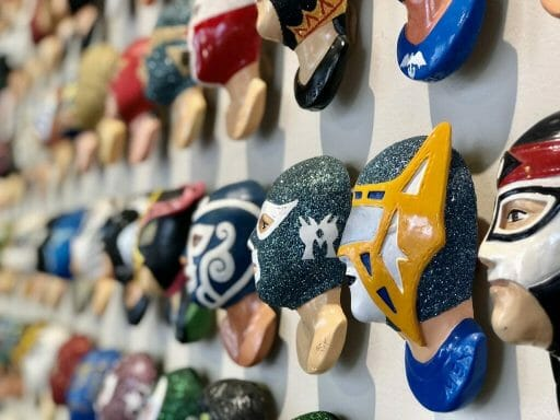 Wall with miniature lucha libre masks at Mullme Museum - Lucha Libre Museum Tijuana