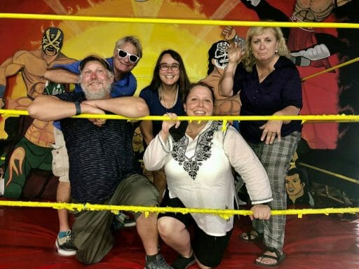 5 people posing in a Lucha libre ring at the Mullme Museum Tijuana