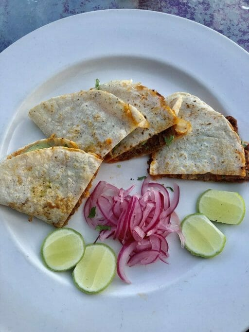 Rabbit Quesadillas with red onions and lime wedgesTelefonica Gastropark