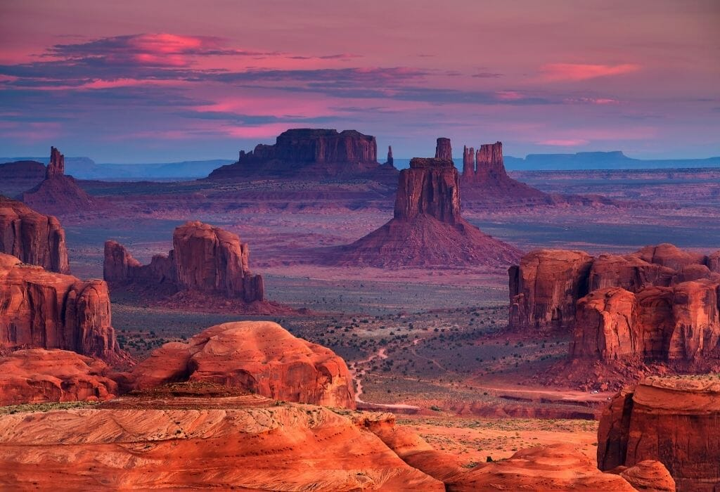 Sunrise over the red rock formations at Monument Valley Arizona